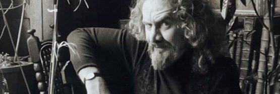 Artist Geoffrey Key sitting in studio